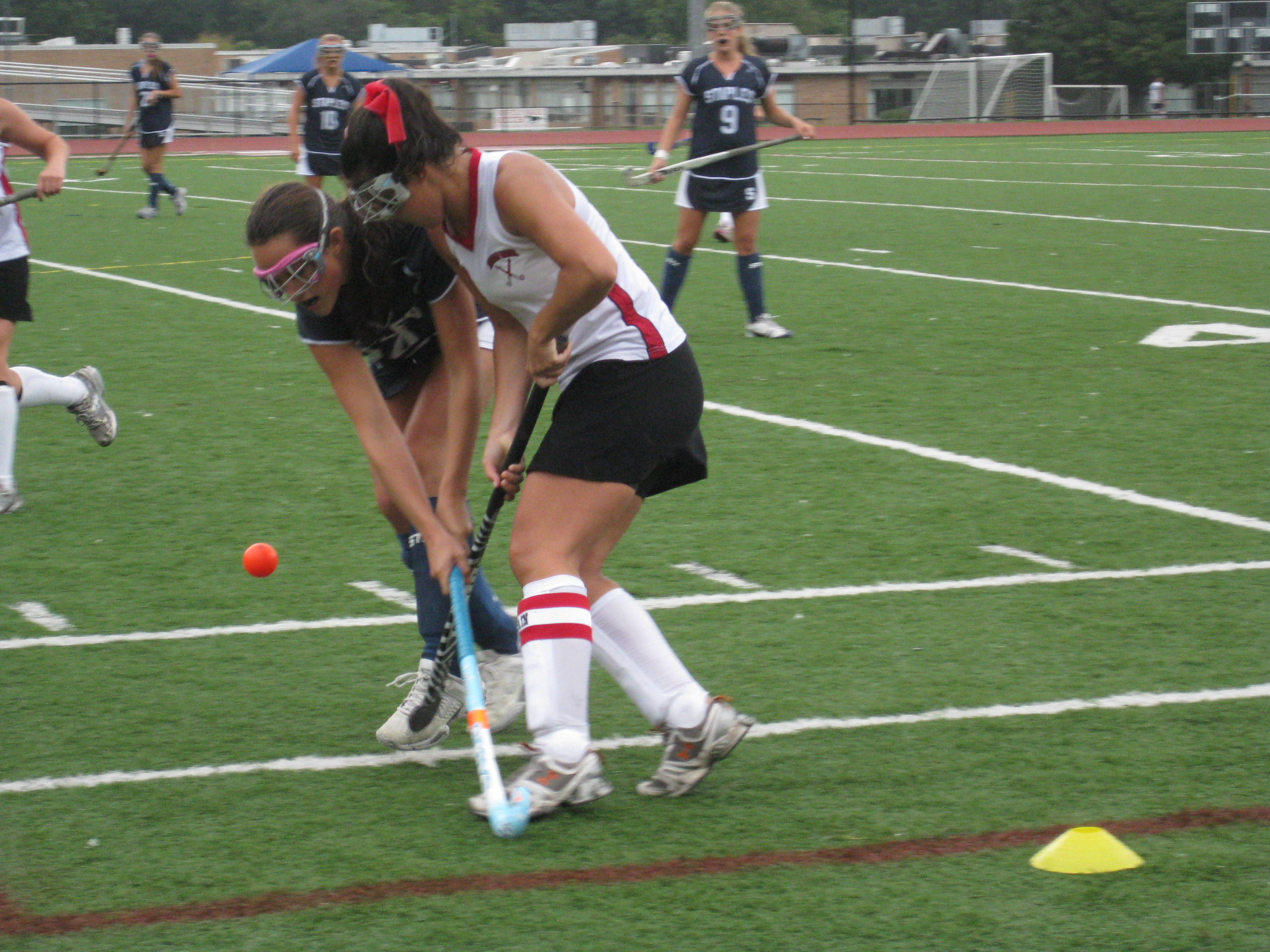 Forward Caroline Steffen '10, fights to bring the ball up the field.