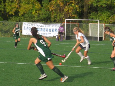 Sammie Hardy '11 brings the ball up the field. | Photo by Emily Kowal