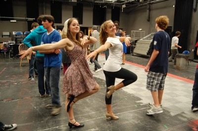 Shannon Walsh '10 and Annabel Burchill '12 practice a dance routine for the show, full of famous musical numbers. | Photo by Caley Beretta '10