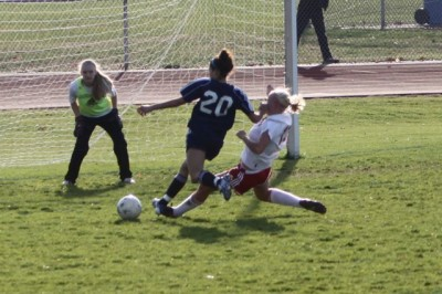 Abbey Lake '12 takes a shot on goal. | Courtesy of www.staplesgirlssoccer.com