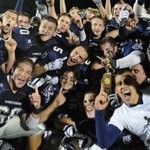 The Wreckers celebrate a thrilling 14-10 victory over Central in the FCIAC championship game.