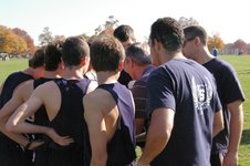 Cross Country coach Laddie Lawrence gives the team an inspirational speech before each meet.
