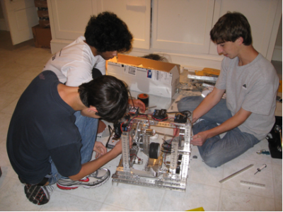 Hard at Work: Eric Lubin '11, Haris Durrani '11, and Todd Lubin '11 study and work on the robot they plan to send to the First Tech Challenge robotics competition. |Photo by Kate Mcnee '11