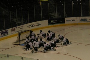 The girls' Ice Hockey team strategizes before the game starts. | Photo by Kate McNee '11.