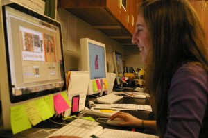 CHRONICLING MEMORIES: Jen Abrams '11, along with the rest of the yearbook staff around her, crafts pages in the yearbook. The staff meets after school every day to take photos and compile a year's worth of information. | Photo by Lila Epstein '10