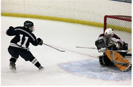 Forrest Savage (Weston High School) takes a shot on goal. | Photo courtesy of www.stapleshockey.com (Anna Andriuk)
