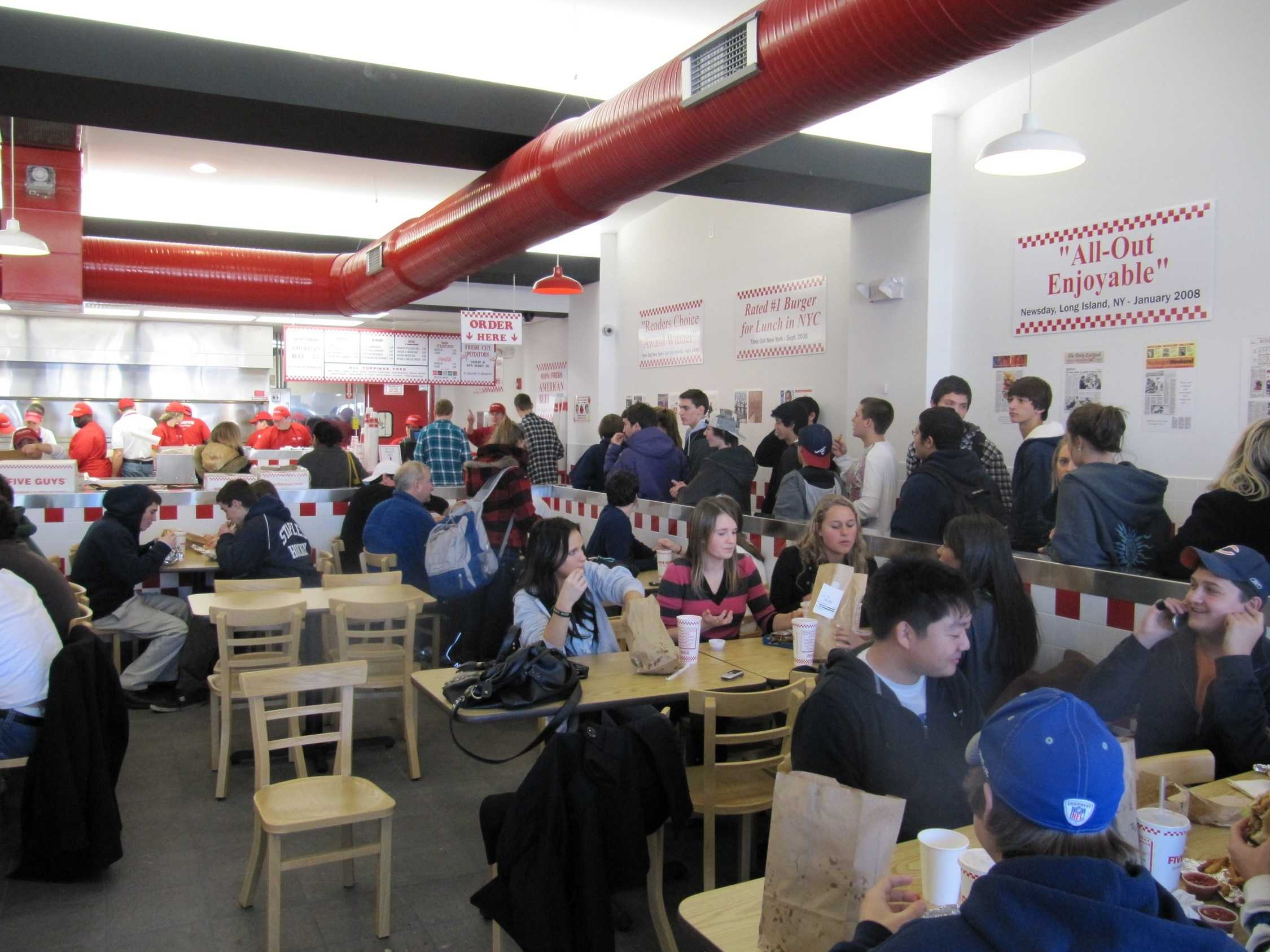 Hundreds of Westporters stopped by the grand opening of Five Guys today to grab a burger. | Photo by Victor Hollenberg '10.