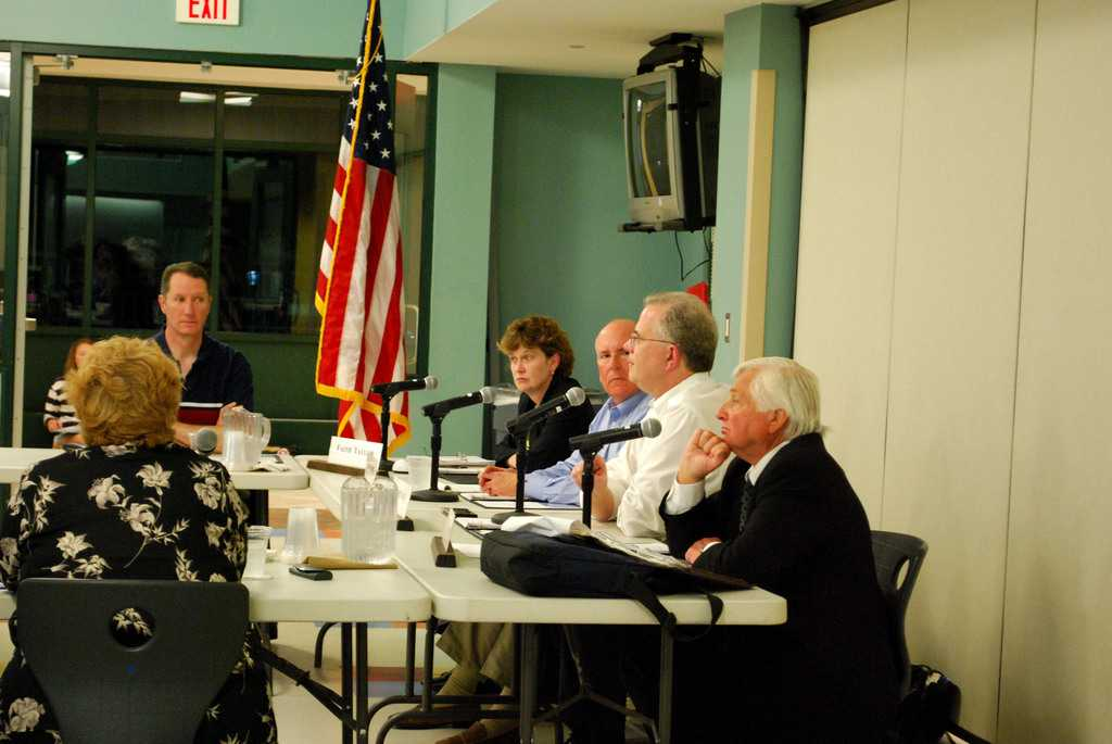 Elliot Landon and other board members listen during a recent BOE meeting. |Eric Essagof '12