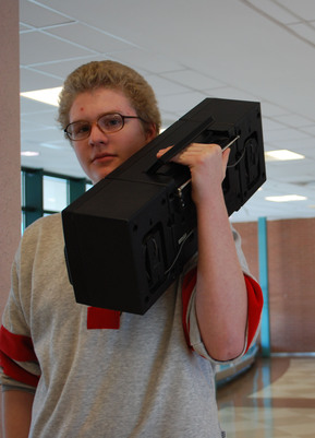Hip Hop Hot Spot: Jamie Morgan '11 blasts beats from his vintage boombox through the second floor hallways on his way to class. | Photo by Madeline Hardy