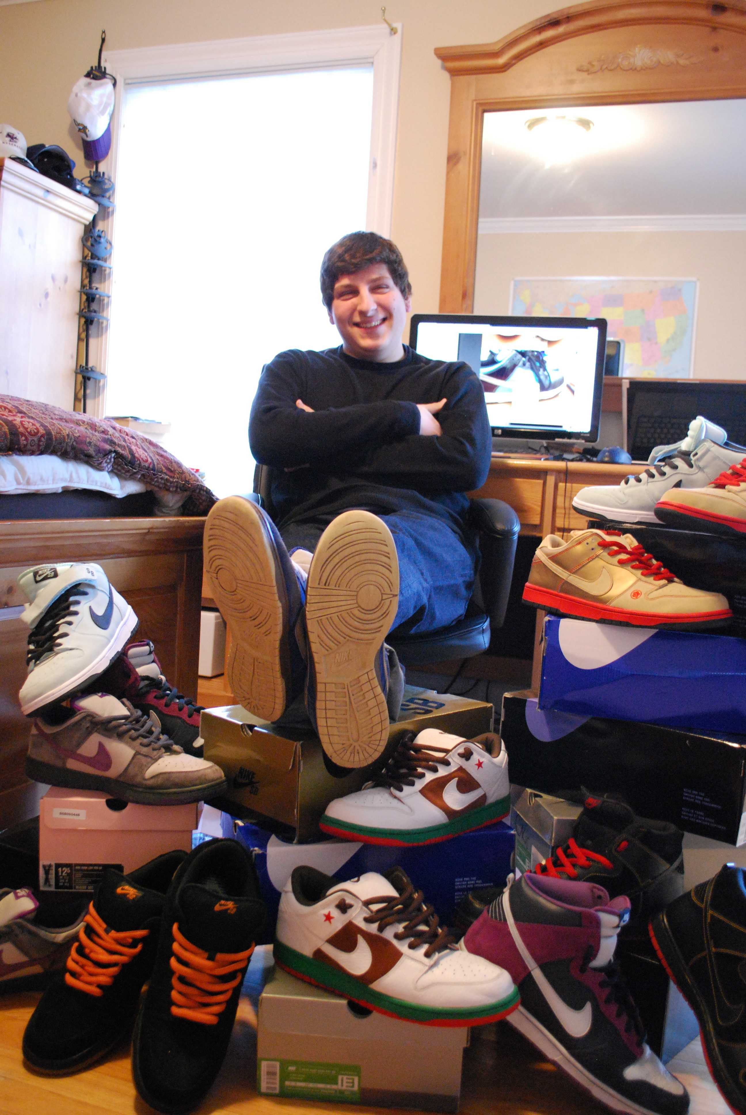 Will Monde '11 sits comfortably amongst his emense collection of sneakers. | Photo by Madeline Hardy '11