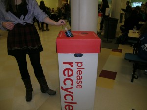 The new recycling bins in the cafeteria are being put to good use.   Photo by Carlie Schwaeber '12