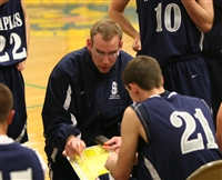 Coach Colin Devine outlines a play to lone Wrecker senior brendan Rankowitz on senior night. Photo courtesy of Staplesbasketball.com (Elaine Rankowitz)