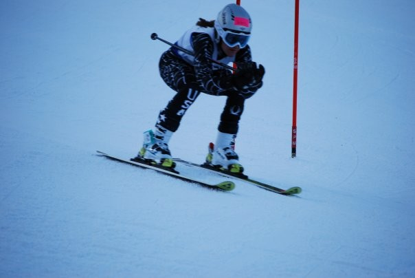 FLYING BY: Melissa Sweeney '11 shreads up the slopes in a  recent CIAC race. She has been a top performer for the  ski team since her arrival at Staples. | Photo by Barbra Sweeney