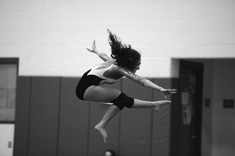 """STICK IT: Emily Fishman '12 finishes her bar routine at the CIAC State Championship. The team later placed sixth at the competition with a team score of 119 points. """"I am happy with the way the season went, we did a lot better than we thought we would,"""" Captain Kara Tricarico '11 said."""