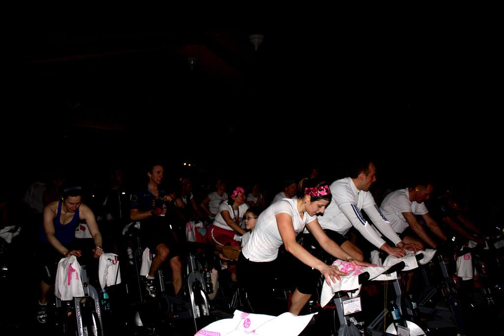 Participants in the Spin Odyssey event exercise on a stationary cycle.  In ten years, this event has raised over 2 million dollars to fund breast cancer research. | Photo by Jordan Ahava '12