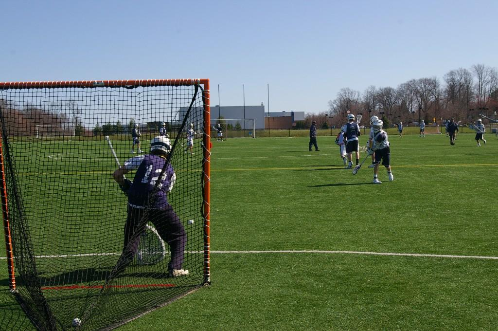 A player practices his shots and warms up the goalie during practice. | Photo by Byran Schiavone '13