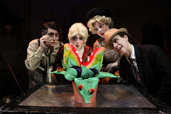 """(From left to right) Dan Shure '10, Eva Hendricks '11, Kathryn Durkin '11, and Adam Bangser '10 marvel at the mysterious killer plant in Players' production of the musical """"Little Shop of Horrors.""""   Photo by Kerry Long"""
