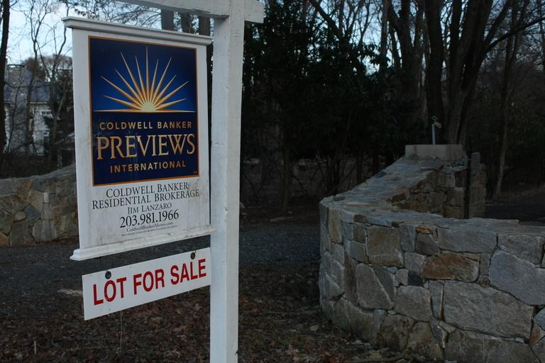 One of the many for sale signs in Westport, which, despite selling fewer units, has weathered the real estate slump better than other towns.    Photo by Mel Mignucci '12
