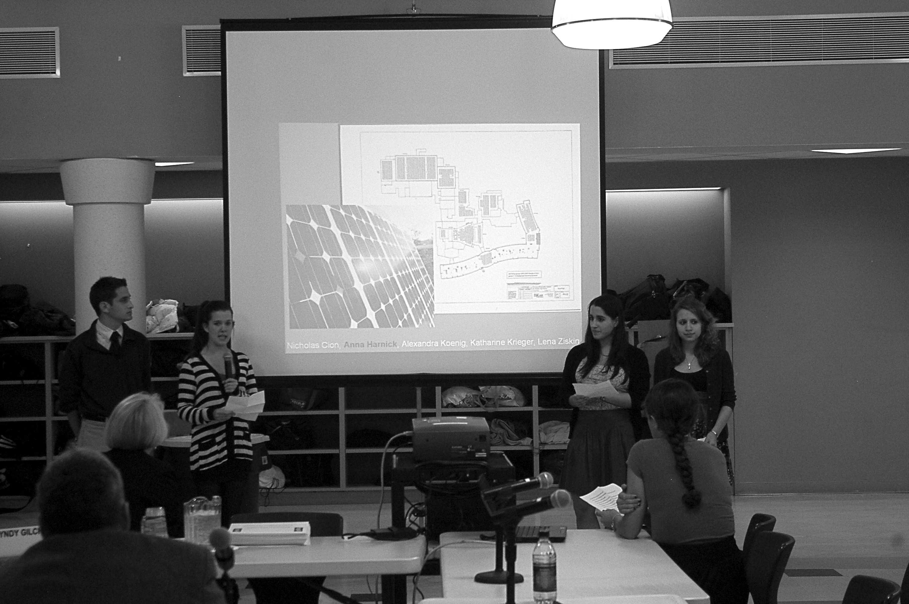 SWEET, SWEET VICTORY: (From left to right) Nick Cion '10, Annie Harnick '10, Lexa Koenig '10 and Lena Ziskin '10 present their winning solution to the BOE at their March 8 meeting. The team, which also included Kat Kreiger '10 won $5,000. | Photo by Petey Menz '11