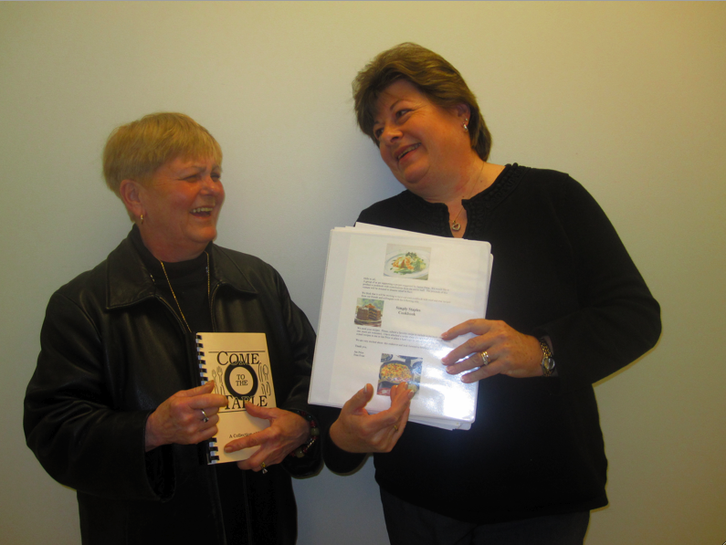 Janice Price (left) and Frances Evan (right) share a laugh over their excitement to put the final touches on the cookbook. | Photo by Devin Skolnick '11