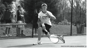 SERVE AND VOLLEY: Danny Hirschberg '11 hits a running forehand during his match.