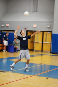 Quint-captain Evan Gaumert '10 gets ready to serve the ball in the first game against the Greenwich Cardinals. The Wreckers will look to win their 8th FCIAC championship Friday night against the Darien Blue Wave. |Photo by Madeline Hardy '11