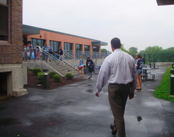 Seniors walk back into the building after Mr. Farnen and other administrators put an end to their water balloon fight in the courtyard. | Photo by Kelsey Landuer '12