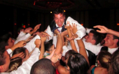 Ian Phillips '10 is one of many students who had a fun filled evening as he crowd-surfs over senior prom attendees. | Photo contributed by Tate Cooper '10
