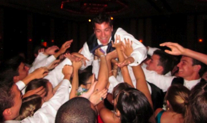 Ian+Phillips+%2710+is+one+of+many+students+who+had+a+fun+filled+evening+as+he+crowd-surfs+over+senior+prom+attendees.+%7C+Photo+contributed+by+Tate+Cooper+%2710+