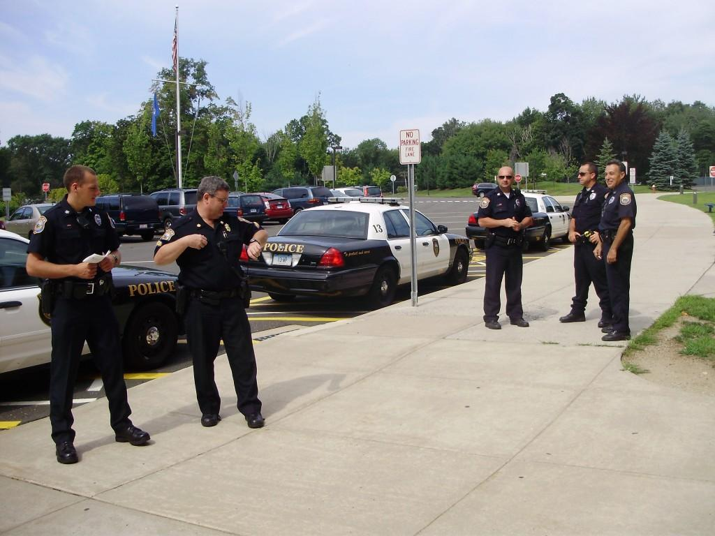 Five Westport Police Officers, including Sgt. Frazier and Officer Loomer on left, familiarize themselves with Staples before all the kids come in. | Photo by Stevie Klein '12