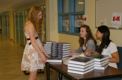 Pippa Hazlewood '11 picks up her 2009 yearbook at the distribution table. Photo by Devin Skolnick '11