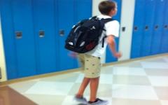 A freshman sprinting to class.
