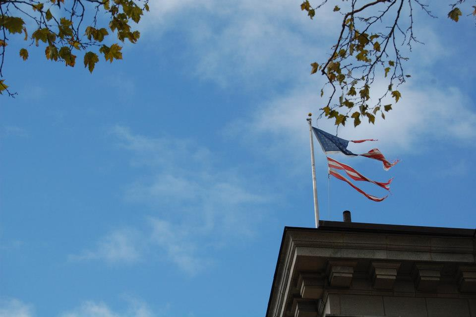 A tapered American flag blows in the post-storm winds.