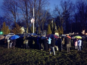 Even in the rain, people pay their respects to the victims of the Sandy Hook shootings