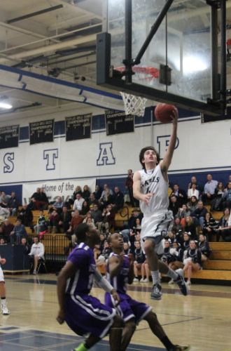 Senior James Frusciante goes up for the lay-up against West Hill.