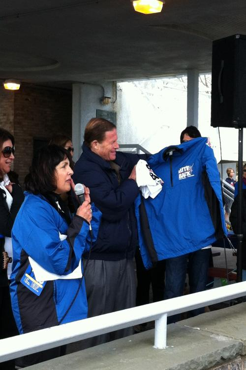 Orna Grand, event organizer for the TBDA, presents senator Richard Blumenthal with a t-shirt and jacket from the TBDA.