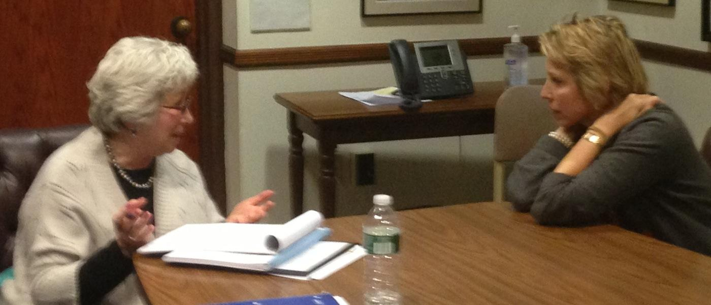 Velma Heller (left) and Clarissa Moore (right) discuss the education budget.