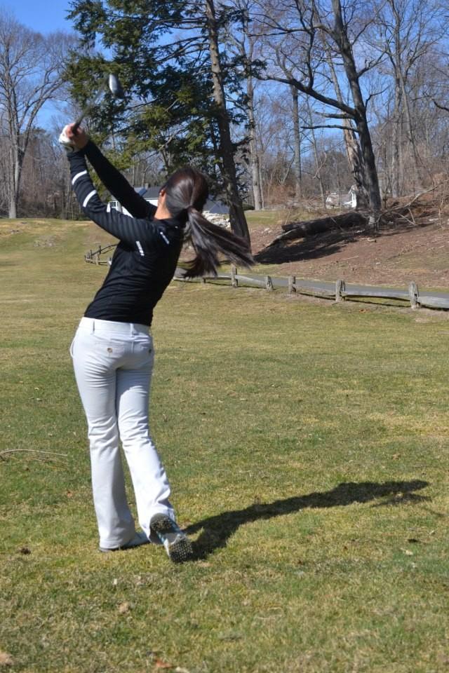 New golf team member Faith Garcia '14 works on her swing
