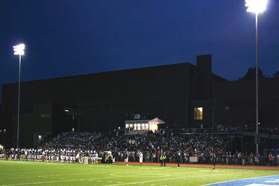Lighting Up The Night: A packed crowd turned out for the first game under the lights last September, a 49-28 victory over St. Joes.