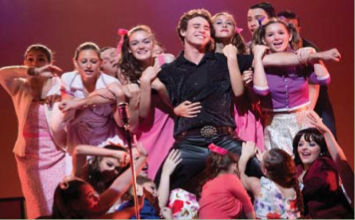 Conrad (Jack Siegenthaller) is embraced by his fan club members.