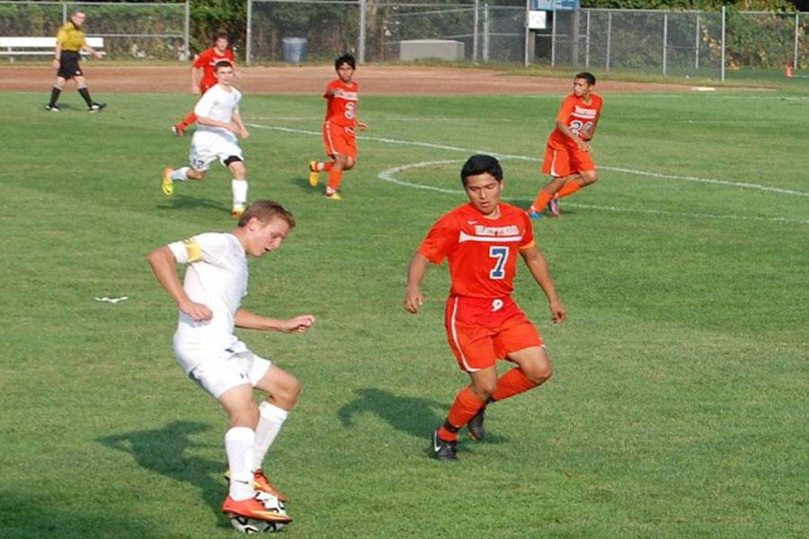 Jack Scott '14 spins on the ball to dodge a Danbury defender.