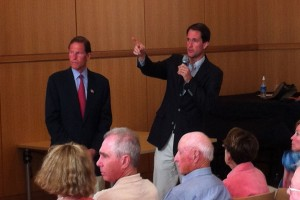 Rep. Jim Himes addresses a speaker from the audience at Sunday's public meeting on Syria.