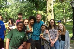 Club members pose with an actor at a Shakespeare in the Parks event this past June.