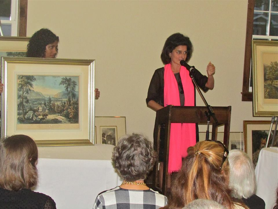 The auctioneer, Jennifer Wright, encourages people to bid for rare prints worth up to $2,000.