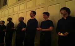 Orphenians members Thomas Bonner '14 and Ian Goodman '15 sing amidst the Norwalk Community College Choir.