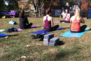 Westporters meditate at the conclusion of a yoga lesson on Veteran's Green.