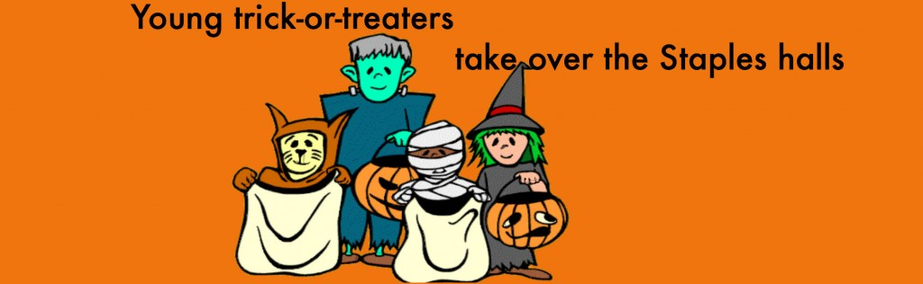 Young+trick-or-treaters+parade+the+school