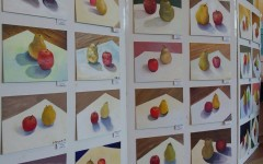 In a Staples oil painting class, students painted pears and apples at a variety of angles, resulting in a whole board of delectable fruit. The difference in styles, brush strokes, shadows, and colors, is dependent upon the individual artist's approach.