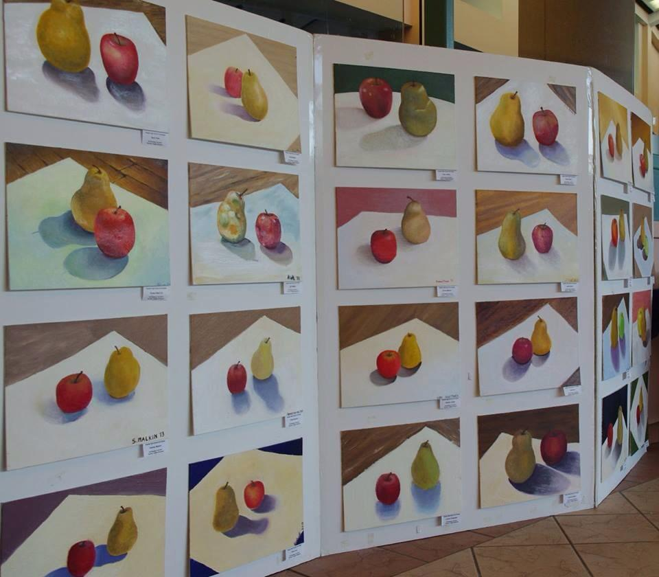 In+a+Staples+oil+painting+class%2C+students+painted+pears+and+apples+at+a+variety+of+angles%2C+resulting+in+a+whole+board+of+delectable+fruit.+The+difference+in+styles%2C+brush+strokes%2C+shadows%2C+and+colors%2C+is+dependent+upon+the+individual+artist%E2%80%99s+approach.
