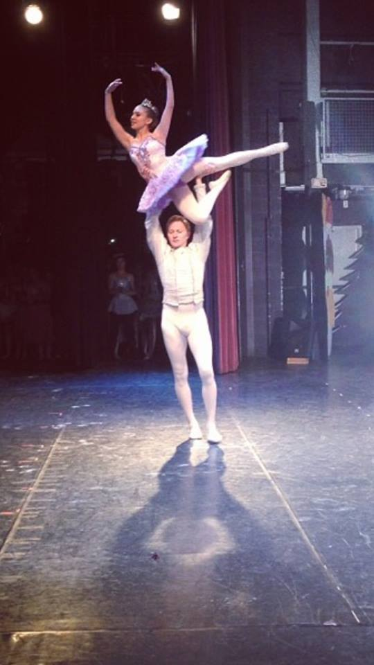 Jessica Riniti '14 rehearses a lift with her Cavalier backstage at Westport Academy of Dance's 32nd annual Nutcracker performance this weekend.